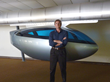 John Cole, New skyTran CEO, in front of Personal Rapid Transit (PRT) vehicle