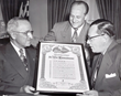 President Harry S. Truman meets with Fraternal Order of Eagles representatives to approve nationwide distribution of The Ten Commandments to combat juvenile delinquency in 1951.