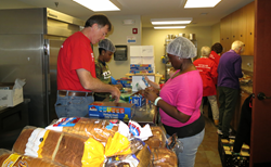 Volunteers assemble lunches for people in need during the 2015 service event at Monte Sano United Methodist Church.