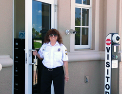 Rida Hernandez, who has a disability, guards the front gate at Hawthorne Community