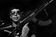 Caracas - Venezuela. A gang member posses for a picture at their hide out.  Copyright Oscar B. Castillo