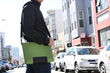 The Maxwell MacBook Sleeve—Kelly green, with shoulder strap