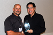 Stanion Electric's Dennis Guey accepts Best Innovation Award from Tour de Force's Matt Hartman
