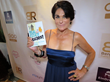 Author Debbi DiMaggio with her latest book, Real Estate Rules! at Doris Bergman's 7th Annual Style Lounge