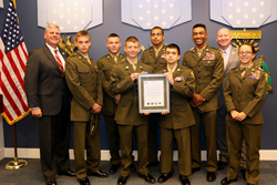 Young Marines holding the Fulcrum Shield award from the United States Department of Defense
