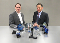 Rich Yezzi, VP of Human Resources, and Mark Muskevitsch, CFO, accepted the 2016 Deloitte Wisconsin 75 Award on behalf of JX Enterprises.