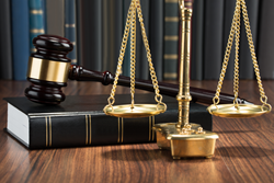 A legal book, gavel, and scales of justice