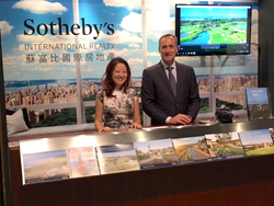 Michael Dreyfus and Ella Liang show Silicon Valley properties at the Sotheby's International Realty desk.
