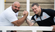 Laurence Shahlaei takes on Newcastle Falcons coach Micky Ward at an arm wrestle