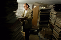 Kanan Makiya examines Ba'ath Era documents recovered by the Iraq Memory Foundation. Photo Credit: Ashley Gilbertson