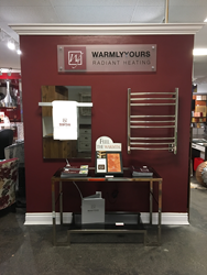 WarmlyYours display includes towel warmer, radiant panel, and more.