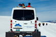 Guests of Wildlife Expeditions winter safaris ride comfortably in custom Mercedes Sprinter snowcoaches and have use of high quality optics for wildlife viewing (photo by Jay Goodrich).