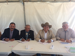 Reclamation Commissioner Estevan Lopez, Isleta Governor Paul Torres, Middle Rio Grande Conservancy District Chairman Derrick Lente and Middle Rio Grande Conservancy District Manager Mike Hamman sign agreement on future management of Isleta Diversion Dam.