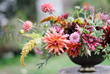 Combine warm and cool floral colors for a surprising palette. Tobey Nelson of Vases Wild in Langley, WA, designs with a fresh mix of ingredients not typically associated with autumn.