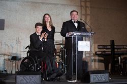Micah Fowler, Children's Specialized Hospital patient and star of the new ABC hit show, Speechless is joined by his parents, Tammy and David Fowler on stage as he shares a few words with the audience at the Children's Specialized Hospital Umbrella Gal