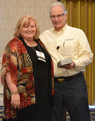 Mary Karpowicz receiving Top Practioner Award