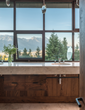 A small custom-made oval stands in for the expected large master bath mirror so homeowners can enjoy dramatic Teton views (photo by Audrey Hall).