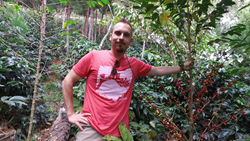 Brandon Bir of Crimson Cup Coffee and Tea with coffee plants in Peru