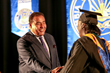 TV show host and famed journalist John Quinones shakes the hand of a graduate at the Columbia Southern University commencement ceremonies.
