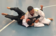 Blind Judoka Edgar Cabachuela competing on the mat at DisAbility Sports Festival at CSUSB