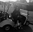 Image of Gabby DiSalvo getting a feel for the chair in her new  handicap-accessible golf car given by CSF and E-Z-GO®.