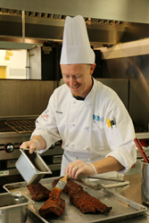 Student chef prepares meat