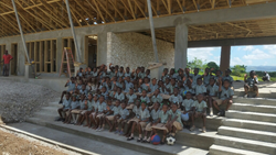 COHH children on the steps of the almost-completed new school. Photo provided by COHH.