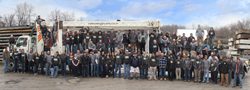 New Energy Works employees gathered for their annual group photo along with their sister company Pioneer Millworks.