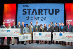 Winners and judges display some of their prizes after the 2016 SPIE Startup Challenge.