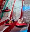 Take a thrilling ride down our two-story tall, 12-lane snow tubing hill made with real snow!
