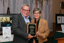 Dennis Ducharme, the 2015 recipient of the Eileen Rice Outstanding Business Leader of the Year Award presents Muffy Copenhaver with the 2016 award.