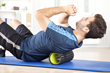 The Tummy Trimmer is a roller device made of plastic and metal that can be  moved up and down in a wave motion to exercise the upper body and create firm abs.
