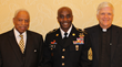 Reverend Ervin R. Graves;  keynote speaker Sergeant Major Corey K. Cush, Troop Command, US Army; and Bruce C. Page, Hospice Chaplain