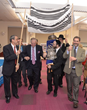 A procession brought the sefer Torah back to the ark in the Hospital's multi-faith chapel.