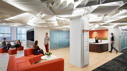 At SmithGroupJJR's new Chicago office,  a spacious lobby provides additional options for breakout or group collaboration. A dramatic ceiling adds excitement. Photograph by Dave Burk