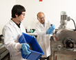 Brajendra Mishra (right), director of WPI's Center for Resource Recovery and Recycling, and post-doctoral fellow Hyunju Lee use a magnetic separator to remove iron oxide.