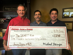 Founding-Partners-Gary-Iscoe-(left)-and-MIchael-Steinger-(right)-presenting-SMART-Ride-check-to-employee-Jimmy-Dejesus