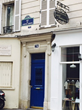 A blue door marks Hemingway's former apartment at 74 Rue du Cardinal-Lemoine, one of many sights on Left Bank Writers Retreat's daily literary tours.