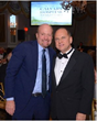 Jim Cramer of CNBC's Mad Money (left) with Henry A. Fernandez.