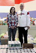 Columbia Southern University Senior Vice President Chantell Cooley and Foley Elementary Principal William Lawrence pose with food donations to Turkey Take-Out.