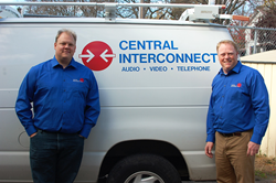Wade Thompson and Neil Brown pose with one of the vans that Central Interconnect uses to service customers throughout West Michigan.