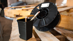A 3D printed trashbin made from Landfillament - a 3D printing material made from garbage.