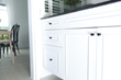 The Instant Cab Lock consists of two J-shaped hooks that can be hooked around the cabinet knobs to hold them in place.