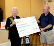 John Owens, C&S Retail Services LLC, Vice President of Merchandising and Marketing (right), presented a ceremonial check to Pat Walker, Lowcountry Food Bank, President & CEO.