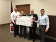 Woodard Raises $37,000 for The BackStoppers, Inc.