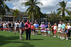Golf Course Superintendent Travis McCoy and Head Pro Joe Jones cut the ribbon to open the Hills and Lakes courses.