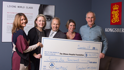 Tanya Hume , Ranald McGillis, and Rachel Lindsay of Kongsberg Geospatial, present a cheque to Tim Kluke and Andrea Timlin (middle) of The Ottawa Hospital Foundation.