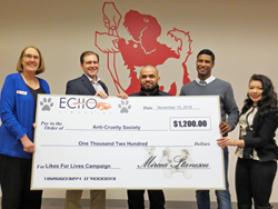 Photo Of Likes For Lives Recipients Holding A Giant Check - Echo Limousine