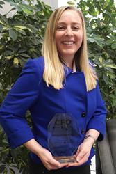Megan Helling holding CFO Award