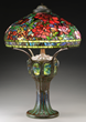 Lot #1216, a Tiffany Studios Peony Table lamp, realized $391,050.